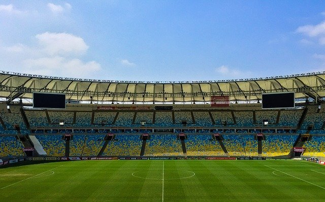 A large stadium with green grass